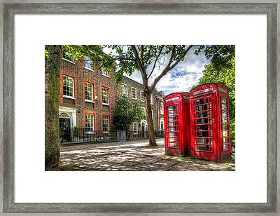 Framed Print featuring the photograph A Pair Of Red Phone Booths by Tim Stanley