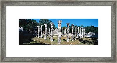 A Panoramic View Of Columns Surround Framed Print by Panoramic Images
