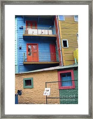 A Patchwork Of Houses Framed Print by Louise Peardon