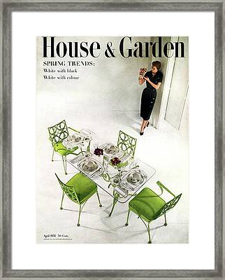 A Patio Table With A Model Standing Behind Framed Print by Herbert Matter