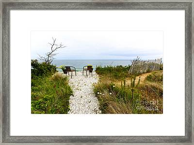 A Peaceful Respite By The Shore Framed Print by Michelle Wiarda