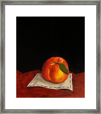 A Peach Framed Print