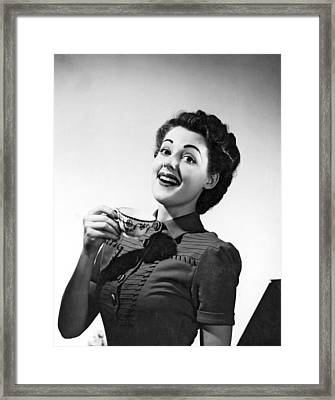 A Perky Woman Enjoys Her Cup Of Coffee. Framed Print