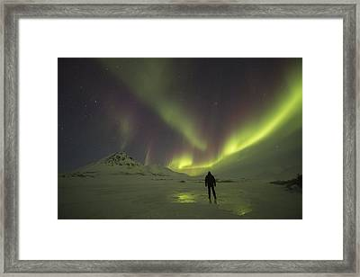A Person Stands On The Frozen Framed Print
