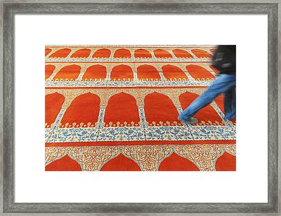 A Person Walking Over The Colourful Framed Print by Keith Levit