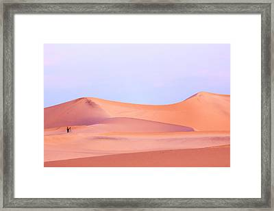 A Photographer Stands In Sunrise Light Framed Print by James White