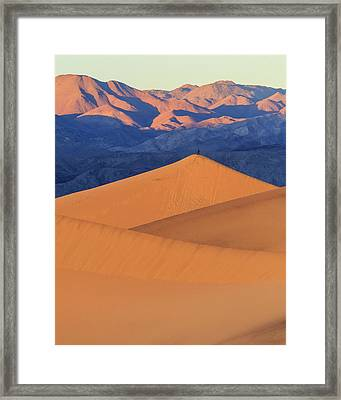 A Photographer Stands On Top Of A Tall Framed Print by James White