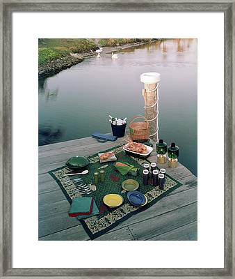 A Picnic Set Up On A Dock Framed Print