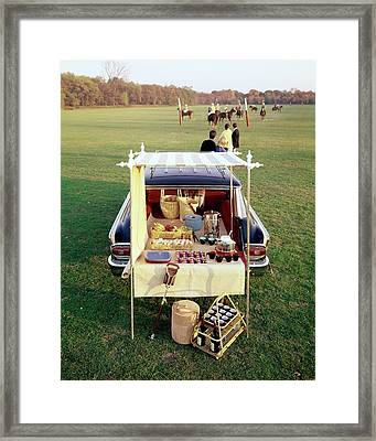 A Picnic Table Set Up On The Back Of A Car Framed Print
