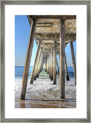 A Pier From Under Framed Print