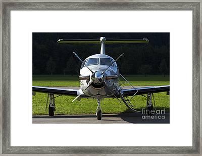 A Pilatus Pc-12 Private Jet Framed Print by Luca Nicolotti