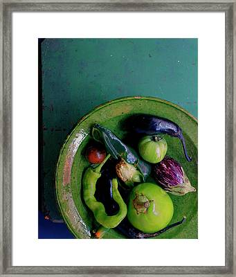 A Plate Of Vegetables Framed Print by Romulo Yanes