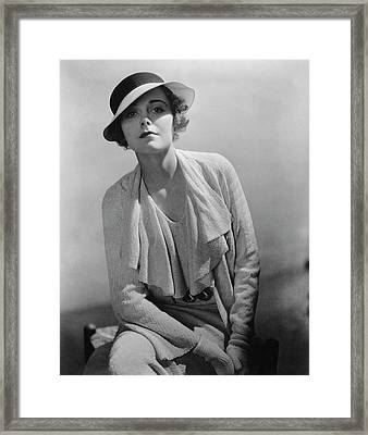 A Portrait Of A Young Model Wearing A Dress Framed Print