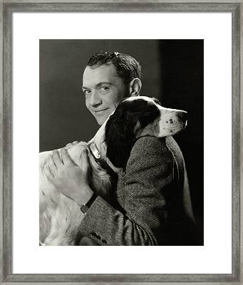 A Portrait Of John Held Jr. Hugging A Dog Framed Print by Nicholas Muray