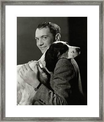A Portrait Of John Held Jr. Hugging A Dog Framed Print