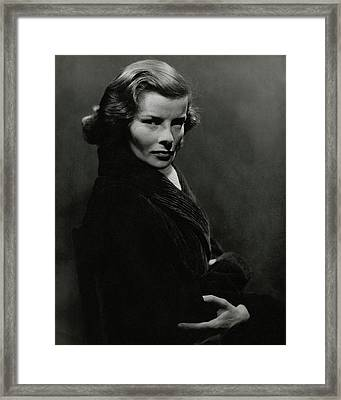 A Portrait Of Katharine Hepburn With Her Arms Framed Print by Lusha Nelson