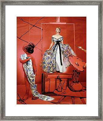 A Portrait Of Lisa Fonnsagrives On A Red Set Framed Print by Horst P. Horst