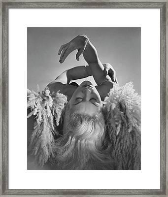A Portrait Of Lisa Fonssagrives Lying Framed Print by Horst P. Horst