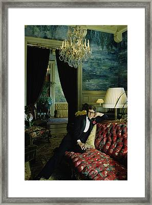 A Portrait Of Yves Saint Laurent At His Home Framed Print