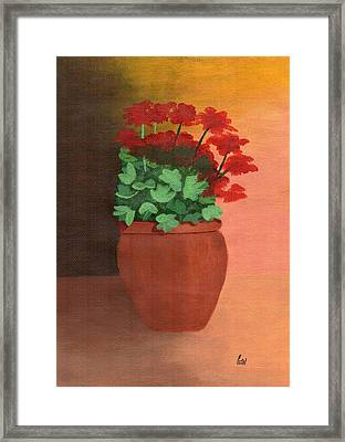 A Pot Of Geraniums Framed Print by Bav Patel