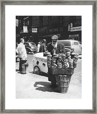 A Pretzel Vendor In New York Framed Print by Underwood Archives