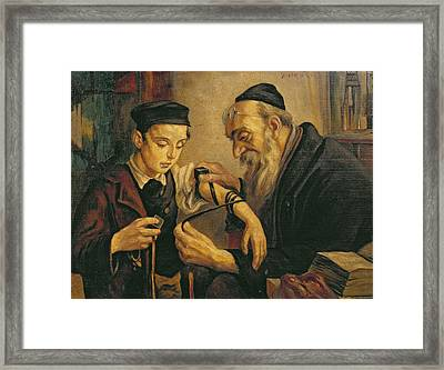 A Rabbi Tying The Phylacteries Framed Print by Jewish School