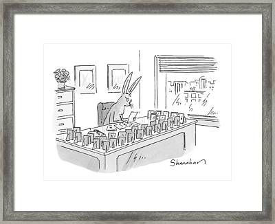 A Rabbit Sits At An Office Desk Framed Print by Danny Shanahan