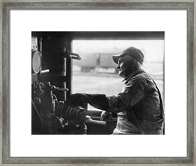 A Railroad Engineer At Work Framed Print by Underwood Archives
