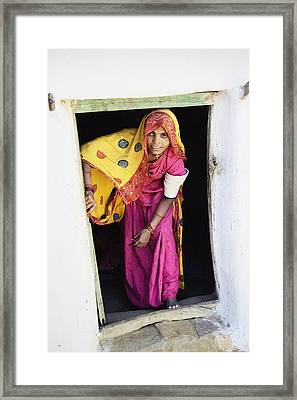 A Rajput Woman Leaving A Building Near Framed Print by Alan Williams