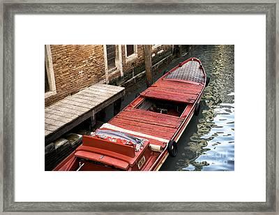 A Red Boat In Venice Framed Print