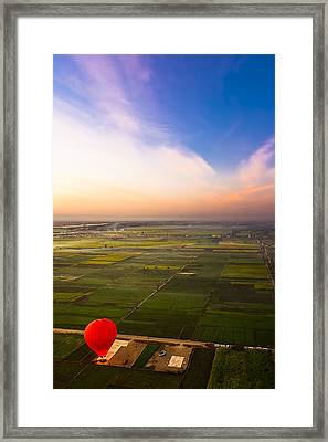 A Red Hot Air Balloon Landing In Egyptian Fields Framed Print by Mark E Tisdale