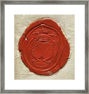 A Red Seal Showing A Coat Of Arms Framed Print