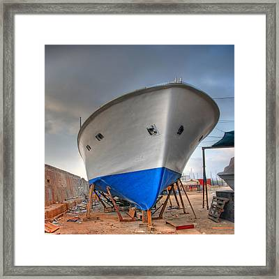 Framed Print featuring the photograph a resting boat in Jaffa port by Ron Shoshani