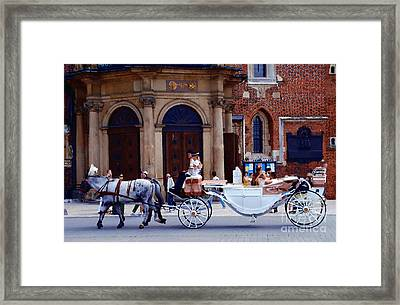 A Ride In Krakow Framed Print by Jacqueline M Lewis