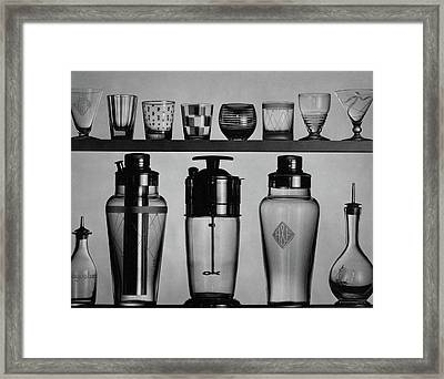 A Row Of Glasses On A Shelf Framed Print by The 3