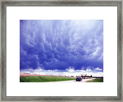 A Rural Nebraska Highway And Magnificent Sky Framed Print by Tyler Robbins