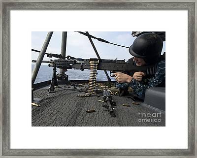 A Sailor Fires An M-240b Machine Gun Framed Print by Stocktrek Images