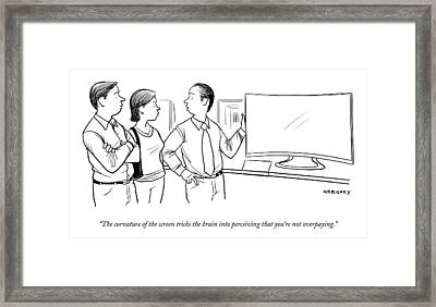 A Salesman Shows A Couple A Large Television Framed Print