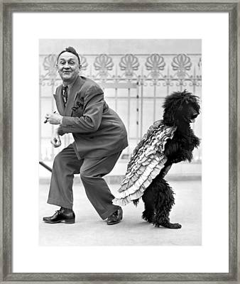 A Samba Stepping Black Poodle Framed Print by Underwood Archives