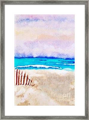 A Sand Filled Beach Framed Print by Chrisann Ellis