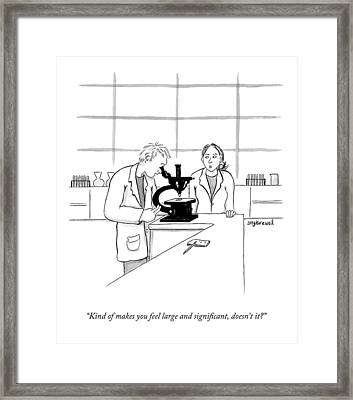 A Scientist Looking Into A Microscope Framed Print by Amy Kurzweil