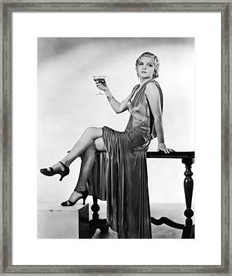A Seductive Woman Toasts With Her Glass Framed Print