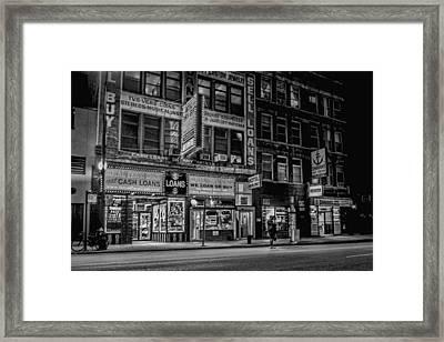 A Seedy City Scene At Night Framed Print