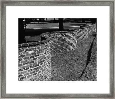 A Serpentine Brick Wall Framed Print