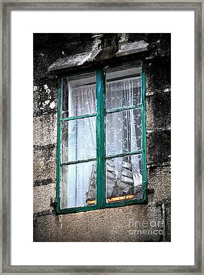 A Ship In The Green Window Framed Print