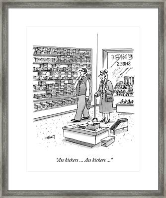 A Shoe Salesman Browses The Selection Of Shoes Framed Print