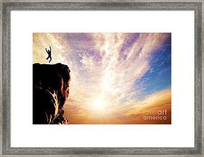 A Silhouette Of A Man Jumping For Joy On The Peak Of The Mountain Framed Print
