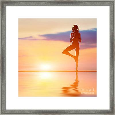 A Silhouette Of A Woman Standing In Tree Yoga Position Framed Print by Michal Bednarek
