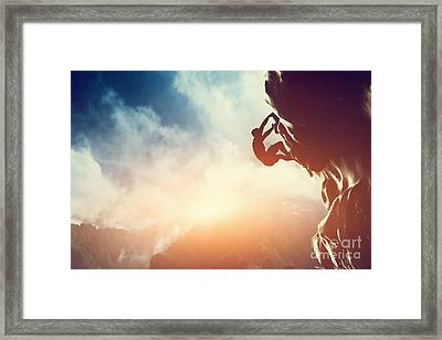 A Silhouette Of Man Climbing On Rock Mountain Framed Print by Michal Bednarek