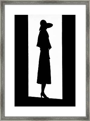 A Silhouetted Woman Framed Print by  Barre